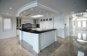 A magnificent art piece composed of mosaic and white gold makes a unique statement above the stove in the spacious kitchen