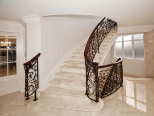 The 'grand escalier' with its intricate iron work wraps itself through three storeys of marble floors